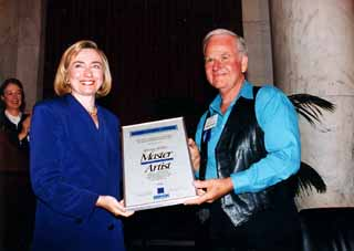 Hillary Clinton presents Gimble with the NEA's National Fellowship Award.